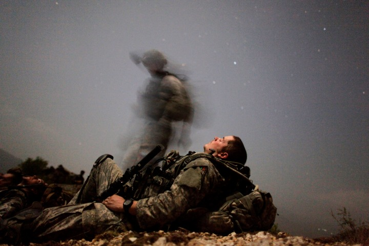 U.S. soldier takes break during night mission near Honaker Miracle camp at the Pesh valley of Kunar Province