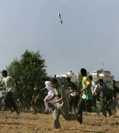 This is a 2008 Pulitzers prize winning picture of a missile, caught in mid-air, as it falls on a target in the Gaza Strip while young Palestinians scramble for safety.