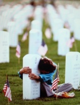 Graveside – taken by Anthony Suau, Memorial Day 1984 - Pulitzer prize winning photograph.