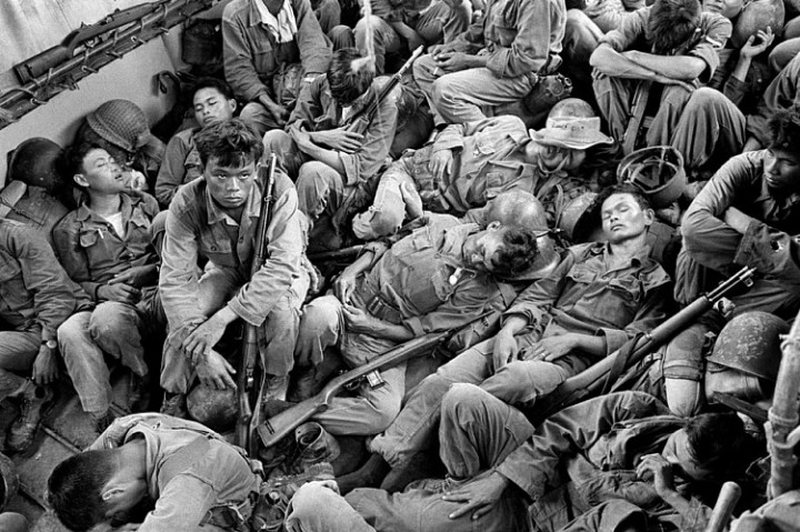 Horst Faas, Exhausted South Vietnamese Soldiers Sleep on a U.S. Navy Troop Carrier Taking them Back to the Provincial Capital of Ca Mau, August 1962