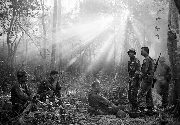 Horst Faas, Sunlight Breaks Through Dense Foliage Around the Town of Binh Gia as South Vietnamese Troops, Joined by U.S. Advisers, Rest After a Cold, Damp, and Tense Night of Waiting in an Ambush Position for a Viet Cong Attack that did not Come, January 1965