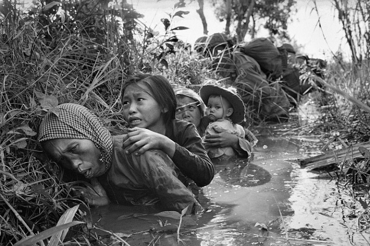 Horst Faas, Women and Children Crouch in a Muddy Canal as they Take Cover from Intense Viet Cong Fire, January 1, 1966