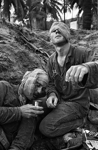 Henri Huet, Medic Thomas Cole of Richmond, Virginia, Looks up with his One Unbandaged Eye as he Continues to Treat Wounded S.Sgt. Harrison Pell of Hazleton, Pennsylvania, During a Firefight, January 30, 1966