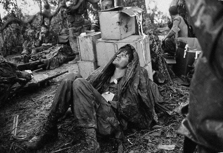 Hugh Van Es, A U.S. Paratrooper Wounded in the Battle for Hamburger Hill Grimaces in Pain as he Awaits Medical Evacuation at Base Camp Near the Laotian Border, May 19, 1969