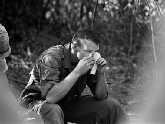Private First Class Clark Richie sniffs the scent of a letter from a girl back home in Jay, Oklahoma. April 1966.