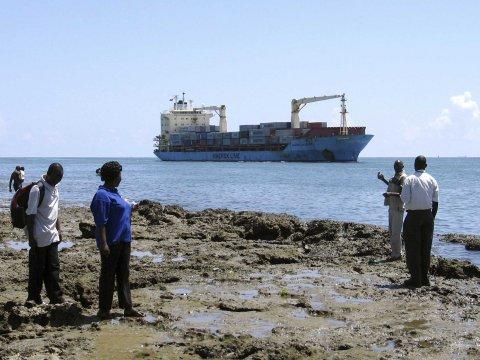 People look at the U.S. flagged container ship, Maersk Alabama as it sails into the Kenyan coastal sea port of Mombasa, November 22, 2009.