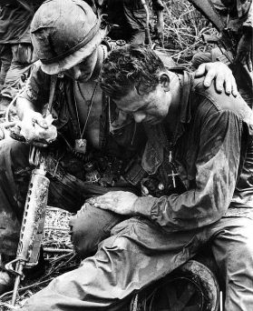 Two soldiers comfort each other under the strain of combat in Pleiku, South Vietnam, 5/26/67.