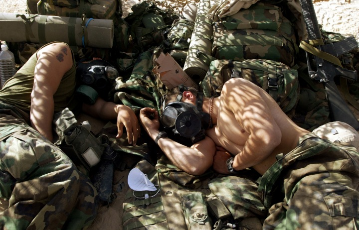 "U.S. MARINES OF THE 15TH EXPEDITIONARY UNIT (MEU) FOX COMPANY ""RAIDERS""SLEEP WEARING RESPIRATORS."