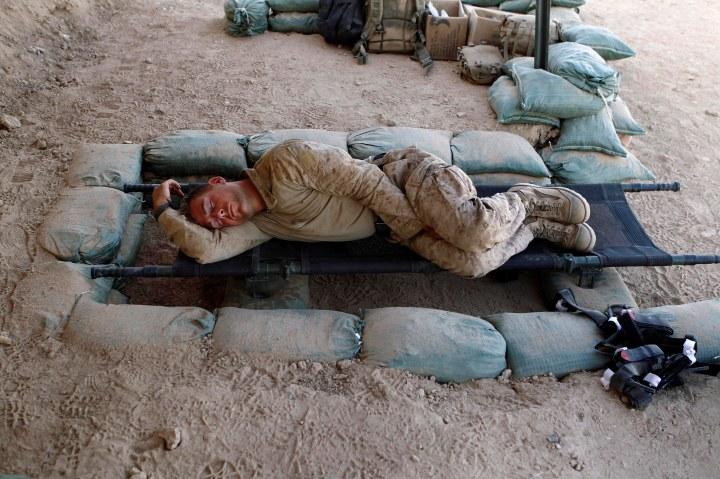A U.S. Marine sleeps in southern Afghanistan's Helmand province