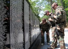 special warfare combatant craft crewmen read names on the vietnam traveling memorial wall during the annual trail of honor