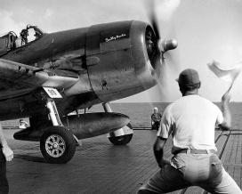 "Grumman F6F-3 ""Hellcat"" flown by Commander Joseph C. Clifton of VF-12, aboard the USS SARATOGA, 1944."