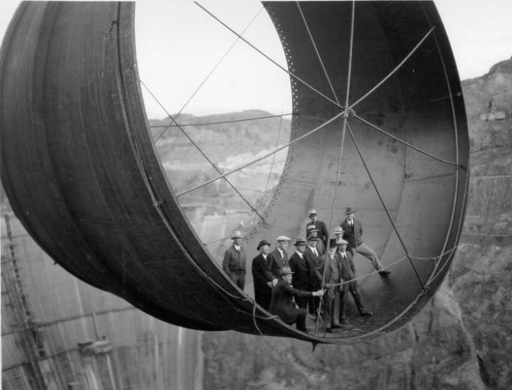 Building the Hoover Dam // Penstock pipe being lowered , 1935