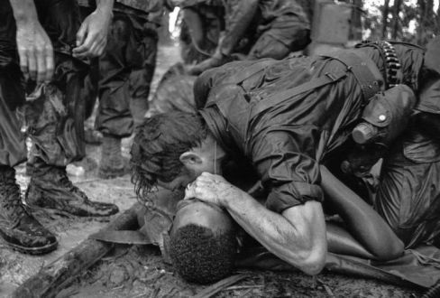 medic of the 101st Airborne Division attempts to save the life of a fellow medic wounded during the assault against the North Vietnamese at Hamburger Hill. May 19, 1969. The wounded medic later died.