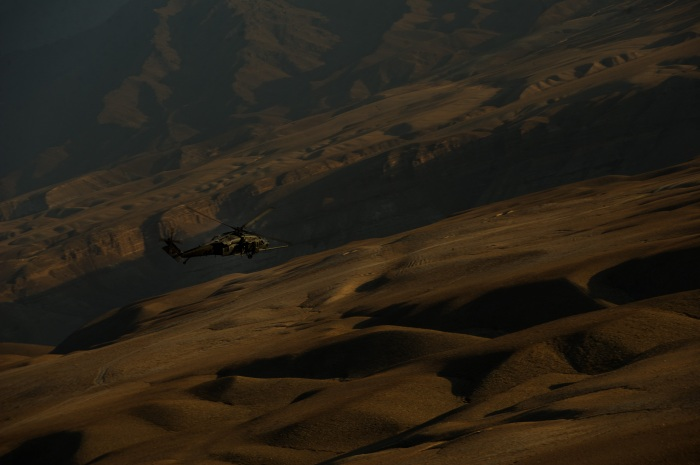 A U.S. Air Force HH-60 Pave Hawk navigates through the terrain during a mission Nov. 7, 2012, over Afghanistan. The primary mission of the helicopter is to conduct day or night personnel recovery operations into hostile environments to recover isolated personnel during war. (U.S. Air Force photo/Staff Sgt. Jonathan Snyder)
