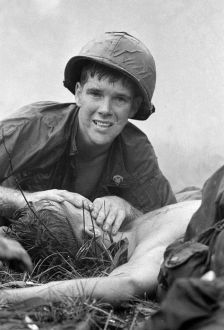 Medic James Callahan attempts to save an injured soldier during the Battle of Saigon.