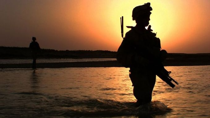 Leading his squad through their daily patrol, Sgt. David McFadden crosses the Helmand River. McFadden is assigned to 3rd battalion, 5th Marine. Helmand, Afghanistan