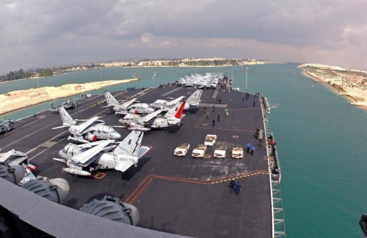 The Nimitz-class aircraft carrier USS Theodore Roosevelt (CVN 71) transits through the Suez Canal.