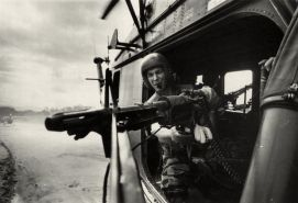 Lance Cpl. James C. Farley, helicopter crew chief mans the gun