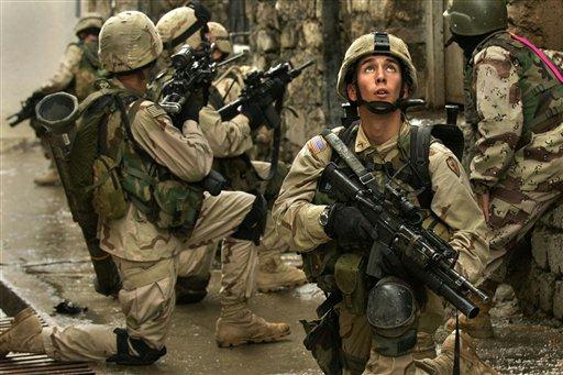 U.S. Army soldiers from the 1st Battalion, 24 Infantry Regiment search for insurgents in Mosul, Iraq, Monday, Nov. 22, 2004. U.S. and Iraqi forces in Mosul