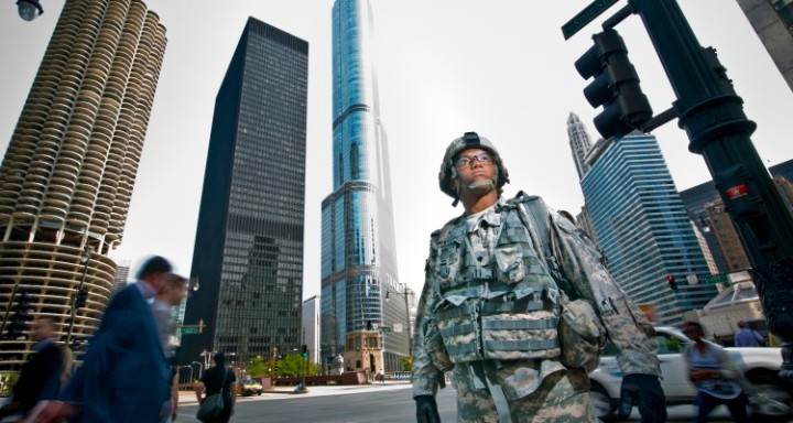 Spc. Nicolas Laboy, an Army Reserve Soldier with the 416th Theater Engineer Command, stands on the corner of a downtown Chicago intersection during a photo shoot designed to promote the partnership between the Reserve force and the Science, Technology, Engineering and Math (STEM) community. Laboy is an information technology specialist with the 416th TEC. (U.S. Army photo by Sgt. 1st Class Michel Sauret)