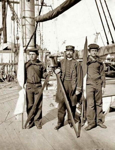 Signalmen of Rear Admiral John A. Dahlgren's flagship receiving a message from the Georgia shore. It was created between 1860 and 1865. The photo illustrates United States Naval Warfare in the Civil War.